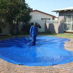 PVC pool cover supporting adult