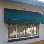 Wedge awning in green canvas with scallops